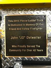 The plaque that was mounted on Ladder 52 in honor of JD