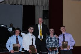Chief Gamon presenting the Chiefs award to Steven Ughy, Luke Suida, Peyton Chippie, & Matt Hautzinger